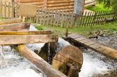 Small wooden waterwheel — Stock Photo