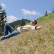 Man relaxing in the mountains — Stock Photo