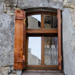 Stock Photo: Wooden window on old degraded wall