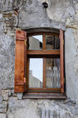 Wooden window on an old degraded wall — Stock Photo