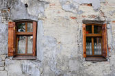 Two wooden windows on an old degraded wall — Stock Photo
