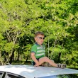 Boy on top of car — Stock Photo #26721017