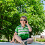 Boy with phone — Stock Photo