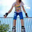 Stock Photo: Young girl rollerskating
