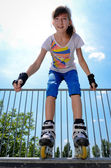 Young girl rollerskating — Stock Photo