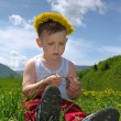 Little boy wearing a dandelion headband — Stock Photo