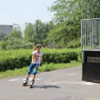 图库照片: Young girl roller skating in skate park
