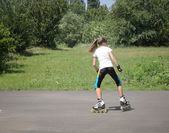 Young girl roller skating — Stockfoto