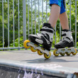 Young girl wearing rollerblades — Stock Photo