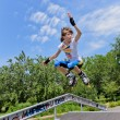 Agile young girl roller skating — Stockfoto #28018885