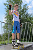 Pretty young teenage roller skater — Stock Photo