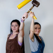 Two women posing with a roller and mallet — Stock Photo #28173063