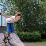 Постер, плакат: Roller skater speeding down a ramp