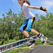 Photo: Agile young girl roller skating