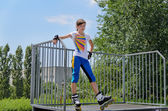 Young girl poised at the top of a skating ramp — Stock Photo