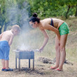 Young boy helping at the barbecue — Stock Photo