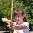 Young girl practising her archery — ストック写真