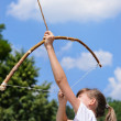 Young girl practising archery — Foto Stock