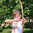Young girl practising with a bow and arrow — ストック写真