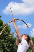 Young girl practising archery — Stock Photo