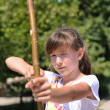 Young girl practising her archery — Stockfoto