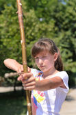 Young girl practising her archery — Stock Photo