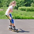 Young teenage girl rollerblading — Stock Photo