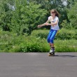 Stock Photo: Teenage girl practising her rollerblading