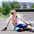 Постер, плакат: Young rollerblader taking a rest