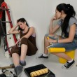 Exhausted women taking break from renovating — Stock Photo #29300597