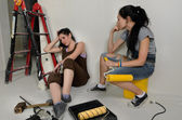 Exhausted women taking a break from renovating — Stock Photo