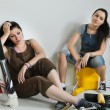 Exhausted women taking break from renovating — Stock Photo #29383461