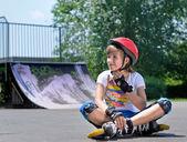 Pretty teenage girl in roller skating gear — Stock Photo