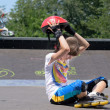 Stock Photo: Young teenage roller skater removing her helmet