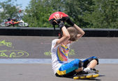 Young teenage roller skater removing her helmet — Stock Photo
