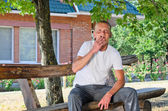 Man puffing on a cigarette outdoors — Stock Photo