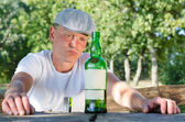 Man with a drinking problem — Stock Photo