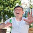 Stock Photo: Laughing drunkard