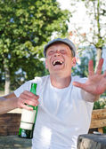 Laughing drunkard — Stock Photo