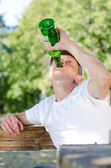 Boozer knocking back the alcohol — Stock Photo