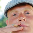 Man smoking a joint — Stock Photo #30594655