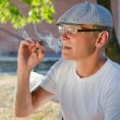 Man smoking a cigarette or joint — Foto Stock