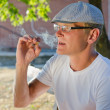 Man smoking a cigarette or joint — Stock Photo
