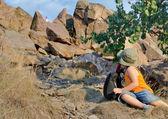 Little boy on a mountainside looking back — Stok fotoğraf