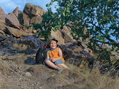 Little boy resting on the mountain in summer — Stock Photo