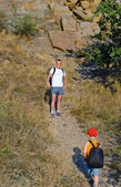 Father waiting for his small son while hiking — Stock Photo