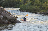 Man rafting with kayak on a fast watercourse — Stock Photo