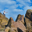 Man on top of a rocky mountain cliff — Stock Photo