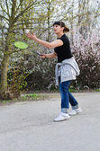 Woman playing badminton — Stok fotoğraf