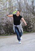 Attractive woman playing badminton — ストック写真